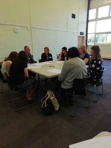 Attendees and the team discussing how IPE can be used in other departments and what the challenges may be.